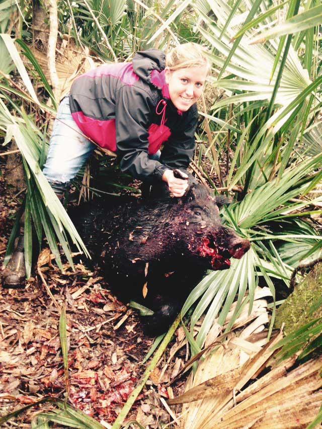 Amazing outdoorswoman Lollar kills a wild boar.