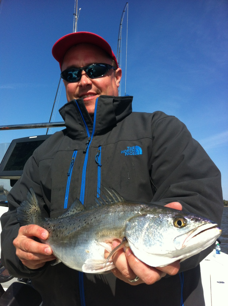 Angler catches a speckled trout wile cold weather trouting.