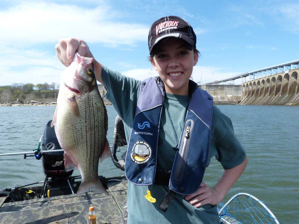 Taylor Barton shows off her success with tailrace fishing.