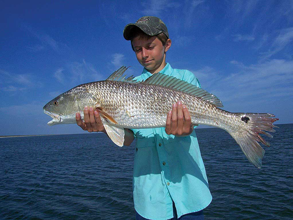 A great redfish catch while inshore fishing.