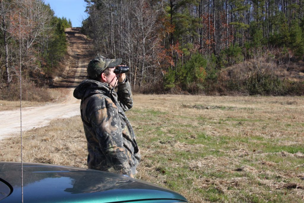 using binoculars to scout is one of the most important early season deer hunting tips for Alabama hunters
