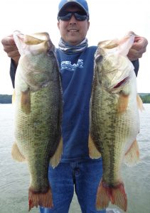Joseph Poole shows off his double success in cold weather bassing.