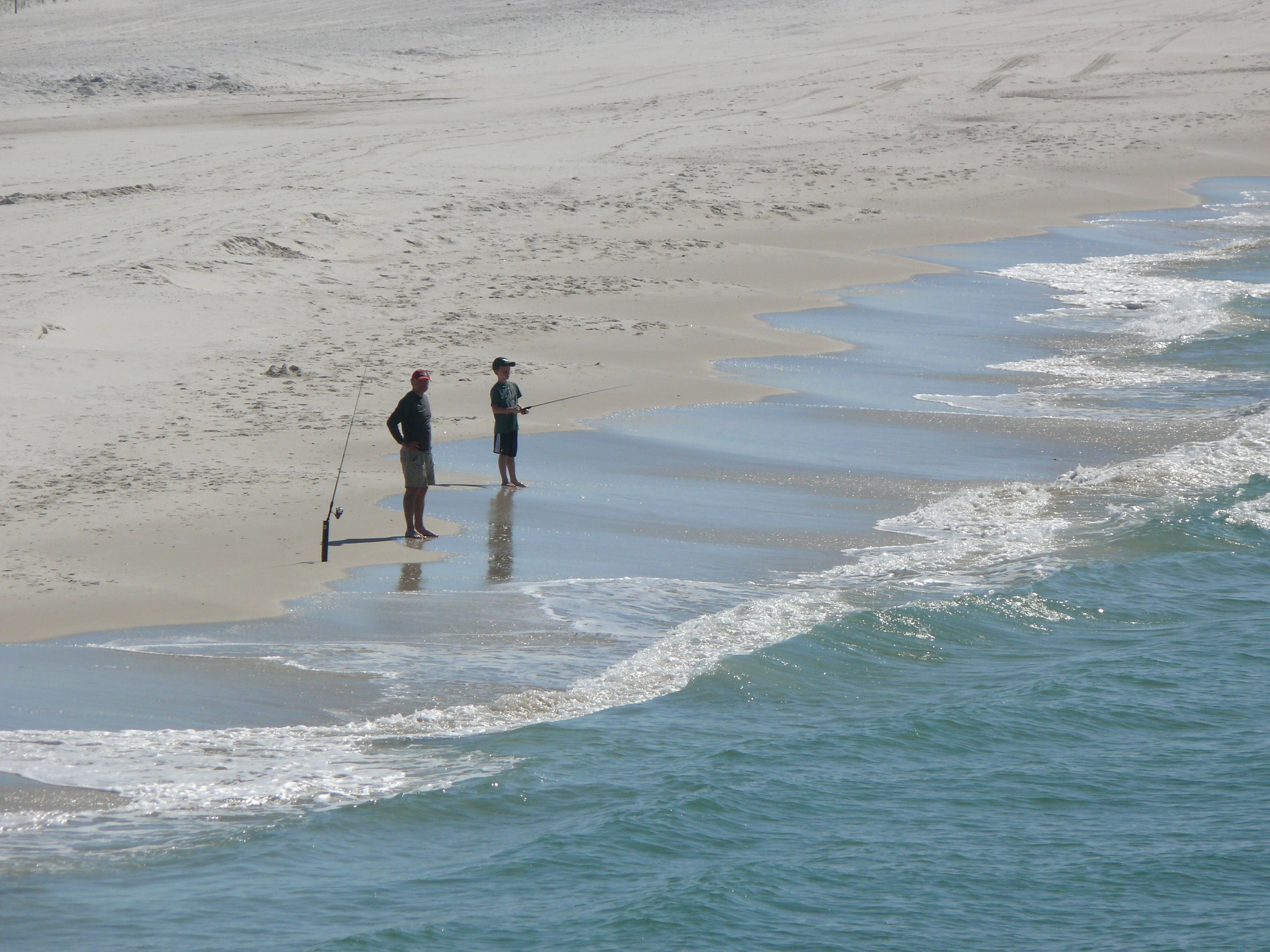 Two anglers fishing for whiting on the Alabama coast.