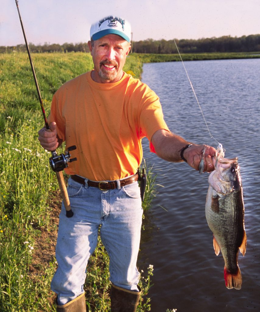 Barry Smith with a farm pond largemouth bass