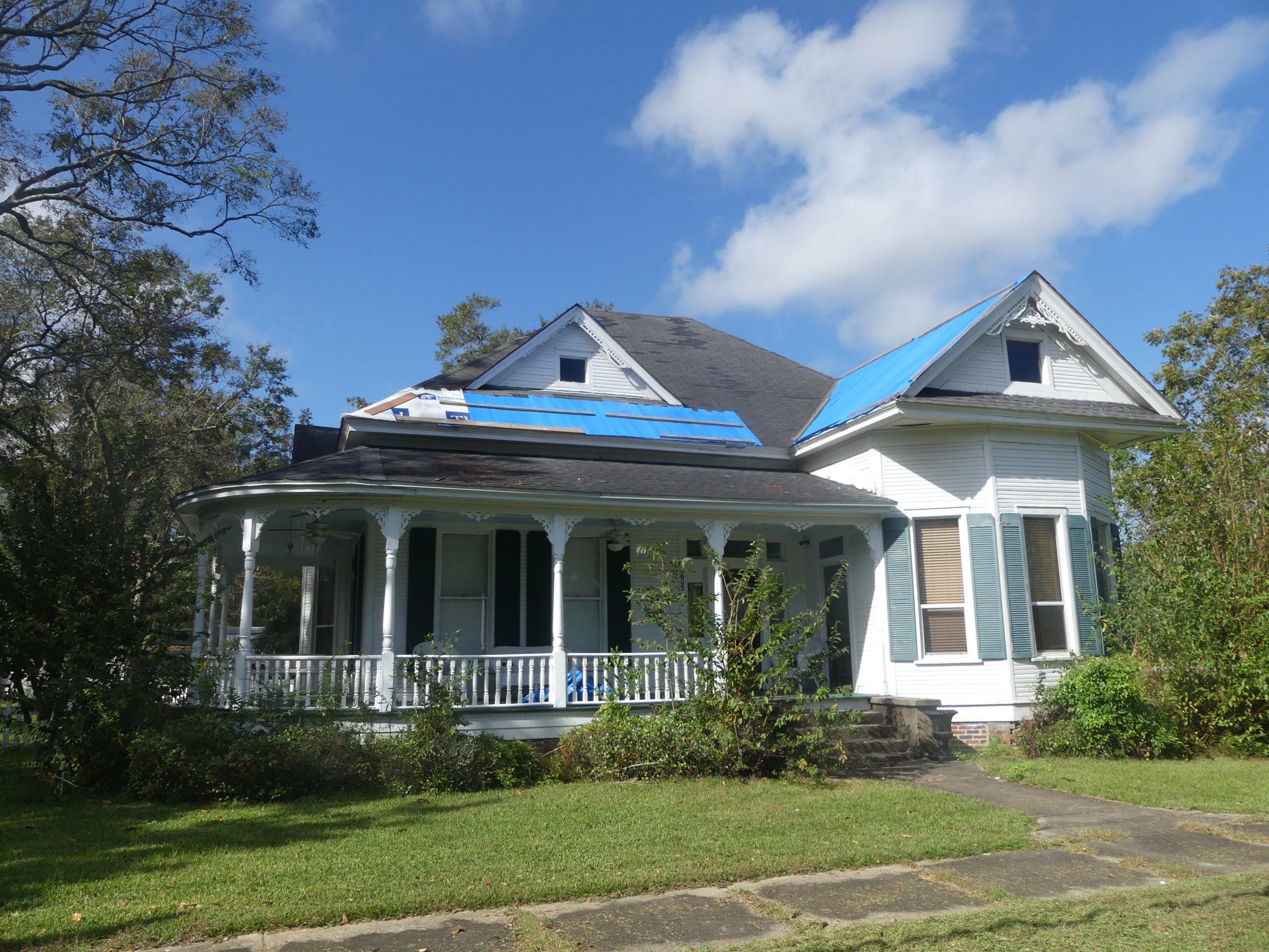 blue tarps over shingles