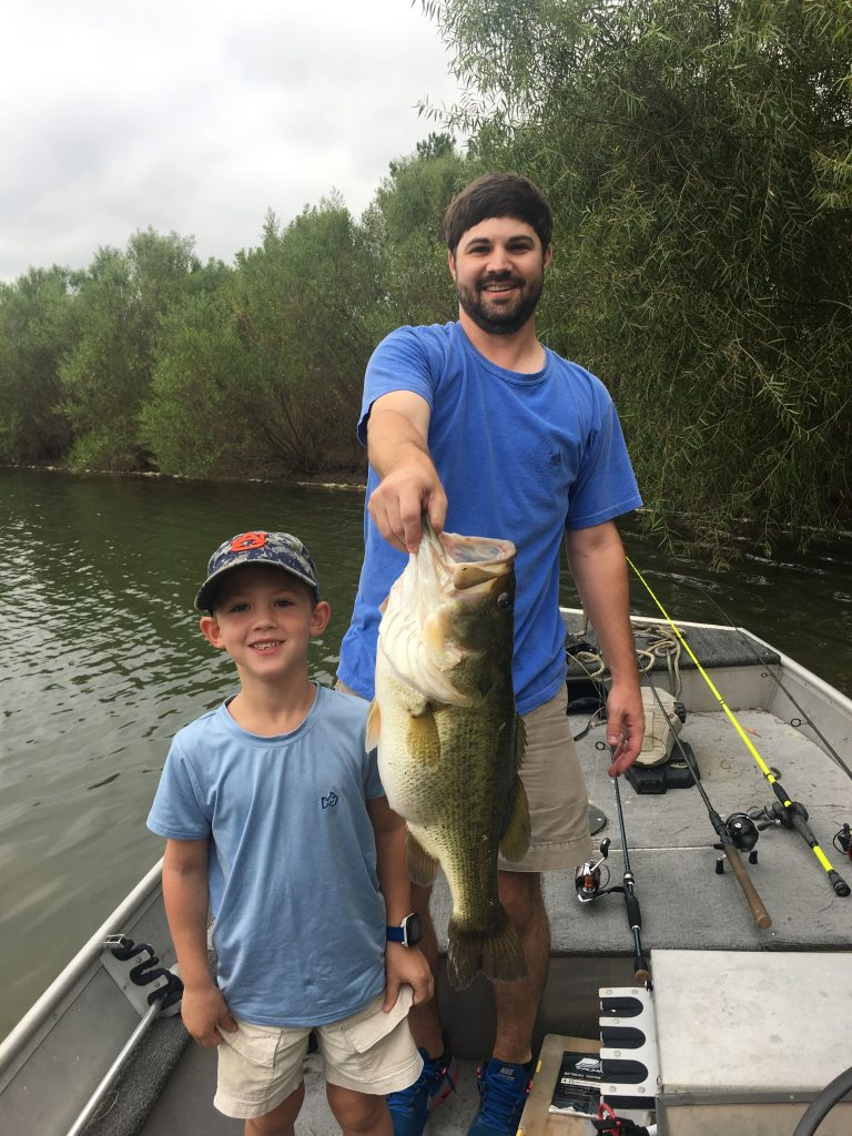 Man and child with large bass
