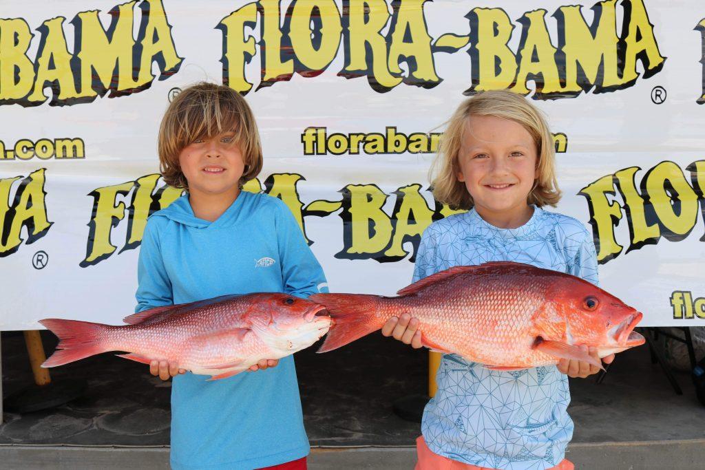 kids holding snapper