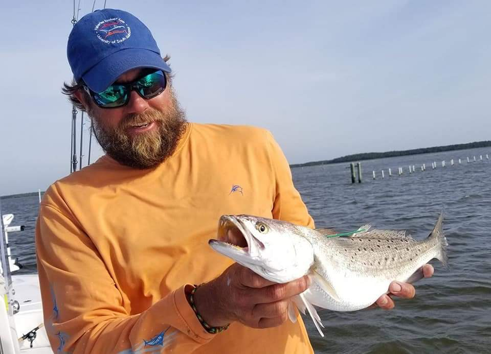 speckled trout being tagged and released