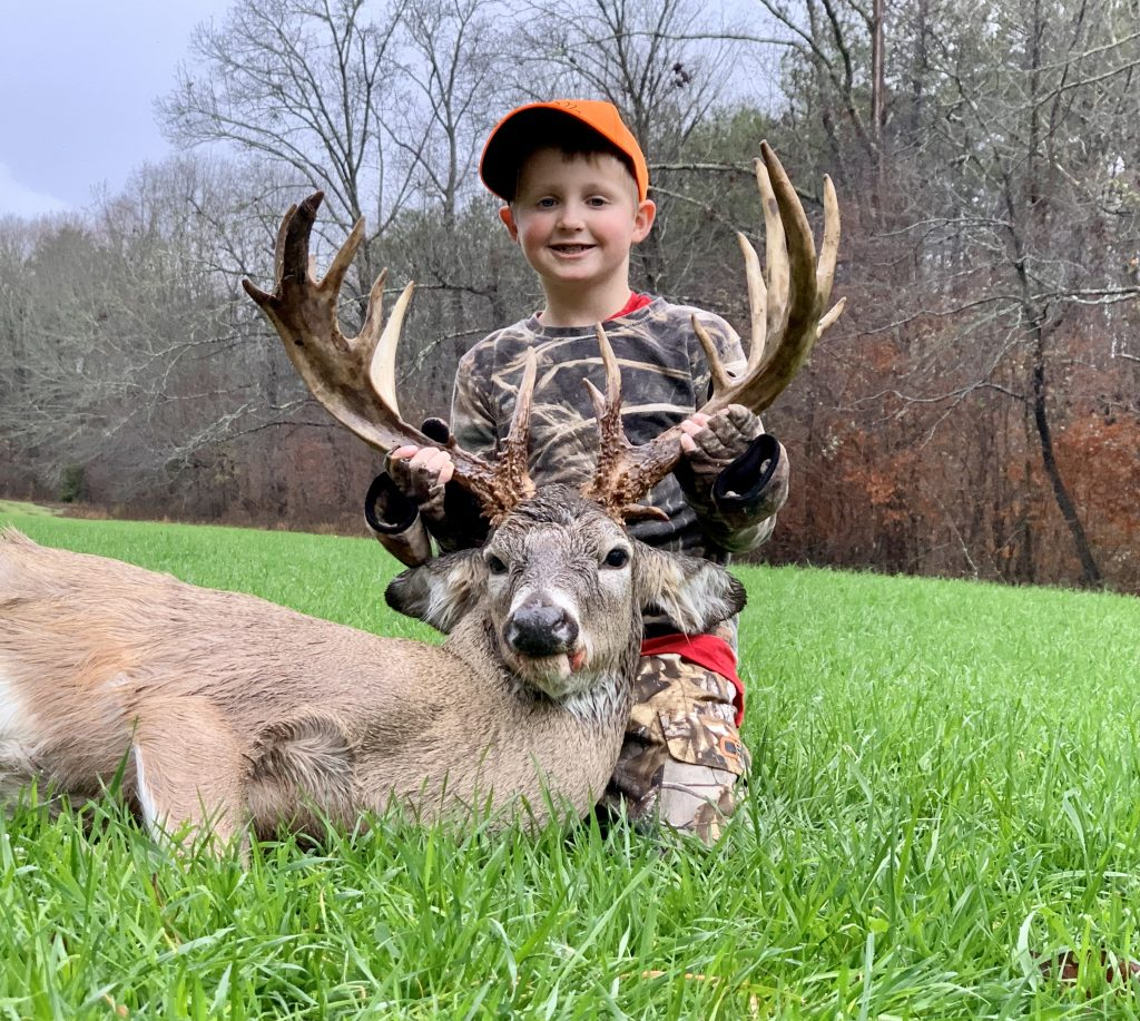 child with 20 point buck