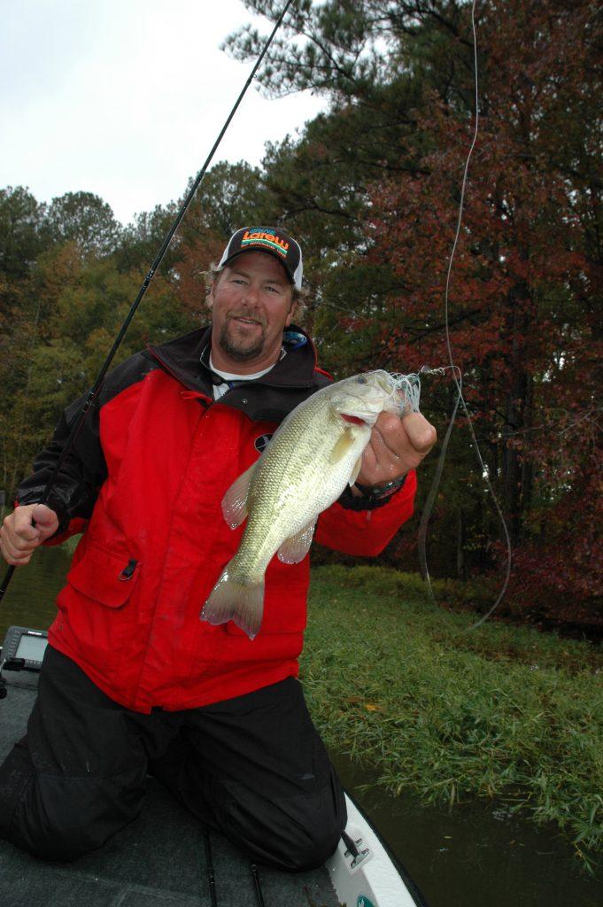 fisherman holding a bass